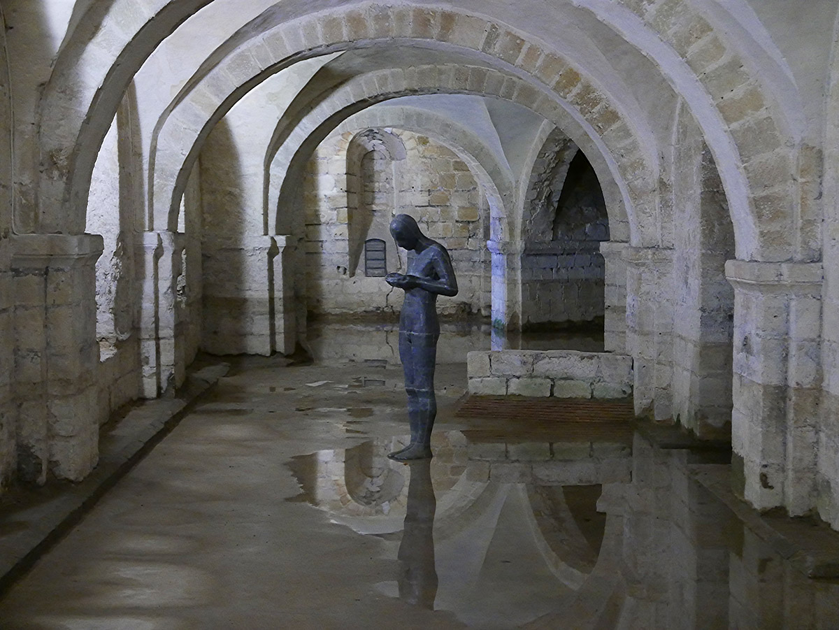 """Antony Gormley's """"Sound II"""" in the Norman crypt of Winchester Cathedral"""